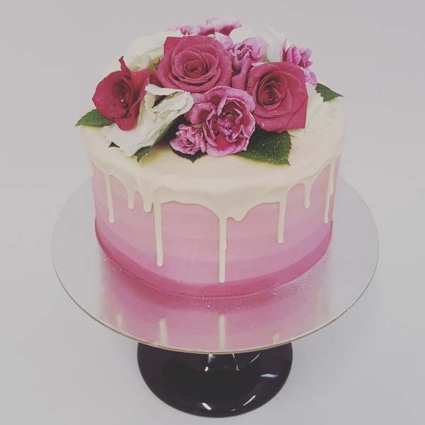Store fresh flower cakes the girl on the swing pink ombre with white chocolate drip and fresh flowers mightylinksfo